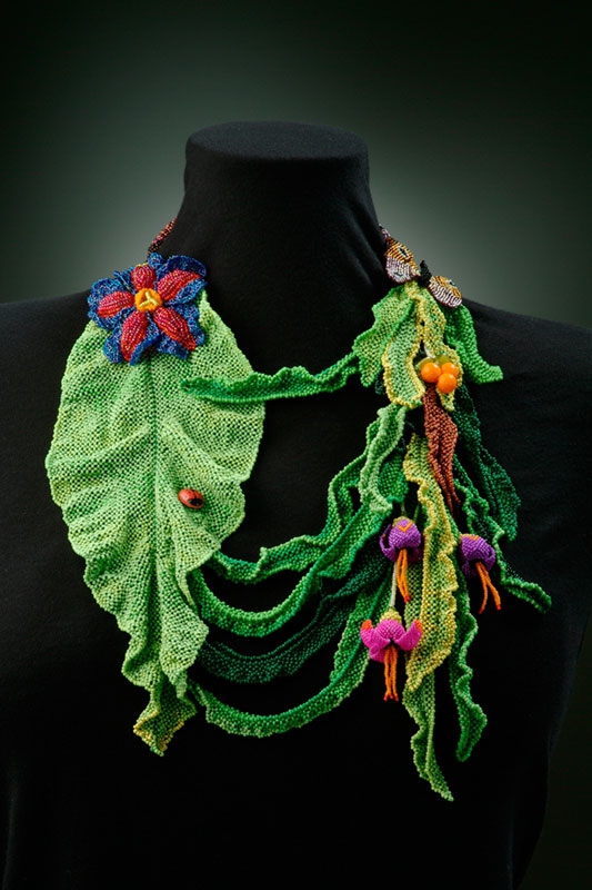 Leaf Lei Off-loom, combination of 5 stitches. This piece was a bead project featured in Bead & Button's December '03 Anniversary issue magazine.