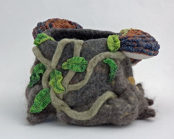 Fun-gi Bowl (side) Alpaca felt, off loom beadwork and bead embroidery techniques. This bowl features indigenous New Zealand fungus and plant species found on tree trunks. $800